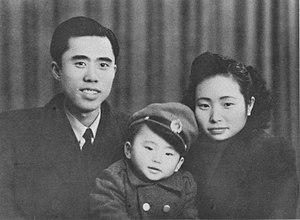 Jiang Zhuyun - Peng Yongwu (L), Jiang Zhujun (R) and their son