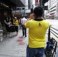 People Power yellow uniform Jean photographer 2012 HK.jpg
