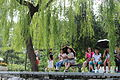 People at the Beihai Park, sitting near the lake.JPG