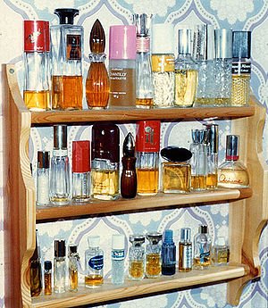 Shelves of perfumes: a closed cabinet, to keep...