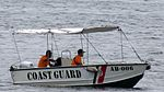 Philippine Coast Guard Boat Monitoring USS Mobile Bay.jpg