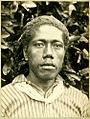 Photograph (black and white); cabinet card; portrait of a man, in front of a bush, wearing a striped shirt and a piece of cloth tied around his neck; Tonga. Gelatin silver print. Oc,B42.9, British Museum.jpg