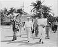 Photograph of President Truman on his morning walk to the beach during his vacation at Key West, Florida, flanked by... - NARA - 200571.tif