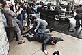 Photograph of chaos outside the Washington Hilton Hotel after the assassination attempt on President Reagan (white border removed).jpg