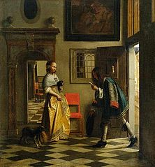 Young woman in an interior, receiving a letter