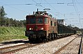 Portuguese locomotive type 2550 with a wood cargo train close to Alcacer do Sal.jpg