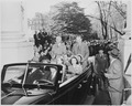 President Harry S. Truman and Vice President-elect sitting on the back of an open car in front of the White House.... - NARA - 199945.tif