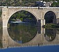 Puente de San Martín and its reflection in the Tagus. Toledo, Spain.jpg