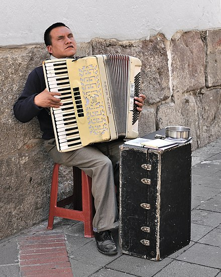 Accordion player in a street in the historic centre of Quito, Ecuador Quito Accordion player.jpg