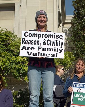 Familialism - A woman at the Rally to Restore Sanity and/or Fear holding a sign that declares her ideas of family values