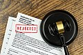 Rejected adoption application form with gavel placed on wooden background. - 51070730302.jpg