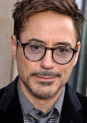 Close up of Robert Downey Jr, wearing tinted glasses at the premiere for his movie Iron Man 3