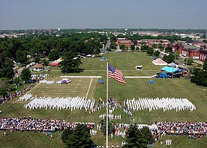 """An aerial view showing a special recruit graduation """"Pass in Review"""" Ceremony held at Ross Field, Naval Training Center Great Lakes."""