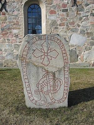 Lovön - Runestone U 47 outside the Lovö church.