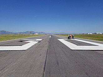 Runway - Runway Identifying numbers being painted at Rocky Mountain Metropolitan Airport (KBJC)
