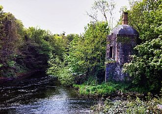 River Rye (Ireland) - Confluence of the Rye (right) with the Liffey (centre to left), at the Boathouse of Leixlip Castle.