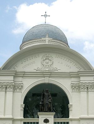 St. Joseph's Institution, Singapore - Sculpture of St John Baptist de la Salle, founder of the Institute of Brothers of the Christian Schools (La Salle Brothers), on the second floor of the portico of the former SJI campus at Bras Basah (see Former Saint Joseph's Institution).