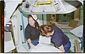 STS096-376-013 - STS-096 - MS Jernigan and MS Tokarev prepare to enter the ISS - DPLA - 1c81f9b321e1822e8036398d288d4c43.jpg