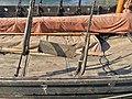 """Saga Oseberg Details wood deck (skipsdekk) wrapped in yard (rå bom) oreholes (årehull) shroud pins (vant) """"Welcome onboard"""" wood carved sign (""""Velkommen ombord"""" skilt) etc. Viking ship replica 2012 Tønsberg harbour Norway 2019-08-2.jpg"""
