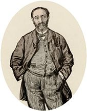 informal portrait of man in early middle age with his hands in his trouser pockets