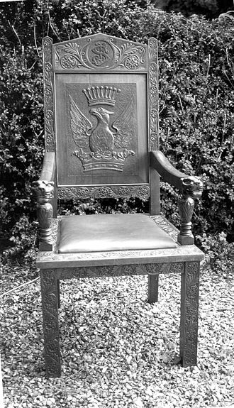 Chair - Early 20th-century chair made in eastern Australia, with strong heraldic embellishment