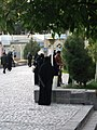 Saudi Arabian woman with Niqab taking photo from Mosque of Mohammad al Mahruq - Nishapur 4.jpg