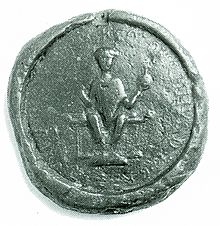 A seal depicting a man on a thrnoe