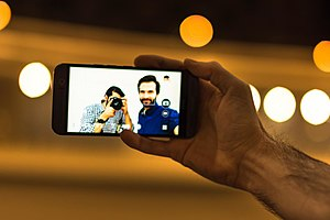 Selfie with both phone camera and DSLR camera.jpg