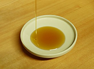 Sesame oil - Dark brown sesame oil derived from roasted/toasted sesame seeds.