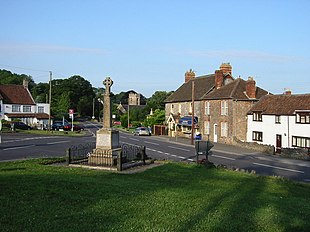 The Square in Shipham with the War Memorial in the foreground