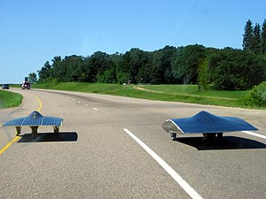 Solar car - Solar cars from University of Michigan and University of Minnesota heading west toward the finish line in the 2005 North American Solar Challenge.