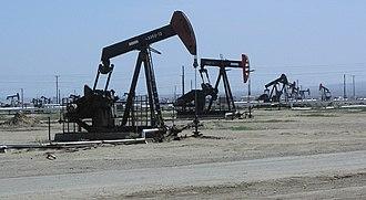 South Belridge Oil Field - A row of nodding donkey oil wells at the South Belridge Field