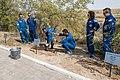 Soyuz MS-15 prime and backup crews during the tree planting ceremony.jpg