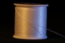 220px-Spool_of_white_thread.jpg