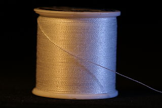 Staple (textiles) textile fibers of similar short length which must be spun together to form yarn