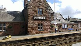 St Bees railway station with sign.jpg