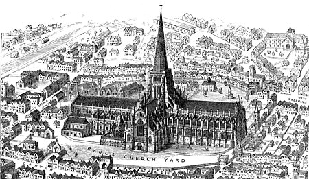 An engraving of Old St Paul's cathedral seen from above. The building is in a cross shape, architecturally rectangular and very long west to east, with flying buttresses along the quire. In the centre is a square central tower, which in this picture has a tall spire. The building looms over the old City of London before the Great Fire.