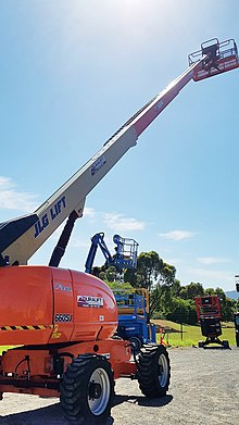 Straight Boom Lift with telescopic boom extended and rough terrain tyres, Duralift Access Hire in Melbourne