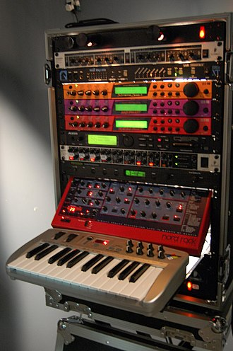 MIDI - Using MIDI, a single controller (often a musical keyboard, as pictured here) can play multiple electronic instruments, which increases the portability and flexibility of stage setups. This system fits into a single rack case, but prior to the advent of MIDI, it would have required four separate full-size keyboard instruments, plus outboard mixing and effects units.
