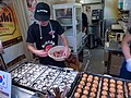 Takoyaki in the Making - Dotonburi (41260922395).jpg