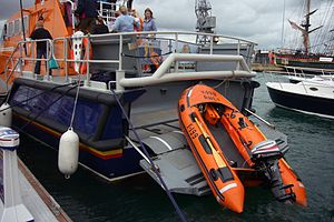 Tamar-class lifeboat - A Y Class inflatable boat on the transom ready to be deployed.