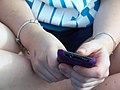 Teen girl texting close-up.jpg