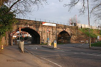 Thames Ditton - Thames Ditton railway bridge-turned-viaduct is a landmark for its scale of brickwork and its layout (of a roundabout beneath it).