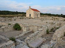 The Ivinj archeological site with Saint Martin's Church.jpg