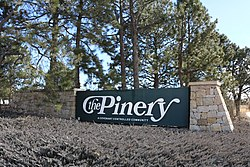 Entrance sign at North Pinery Parkway and State Highway 83.