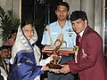 The President, Smt. Pratibha Devisingh Patil presenting the Arjuna Award-2010 to Shri Dinesh Kumar for Kabaddi, in a glittering ceremony, at Rashtrapati Bhawan, in New Delhi on August 29, 2010.jpg