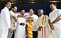 """The Union Minister for Minority Affairs, Shri Mukhtar Abbas Naqvi lighting the lamp to inaugurate the """"Pradhanmantri Mudra Yojna"""" promotion Campaign, in Hyderabad on October 05, 2017.jpg"""
