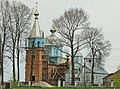 The new church during the construction along with the old in the village Borochiv.jpg