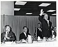Three unidentified men, Kevin H. White (second from left) and Mayor John F. Collins (standing) (13242546035).jpg