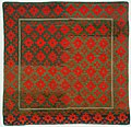 Tibetan wool rug with Gau (amulet) design, woven about 1900.jpg